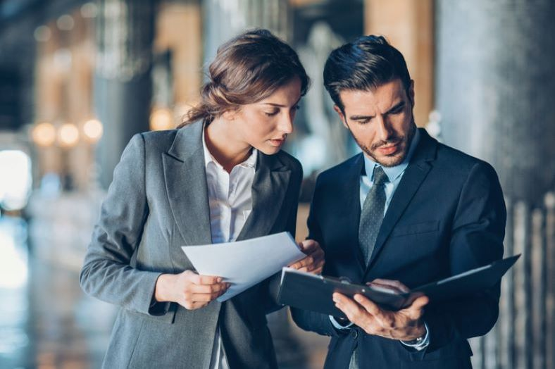woman attorney working with a male attorney